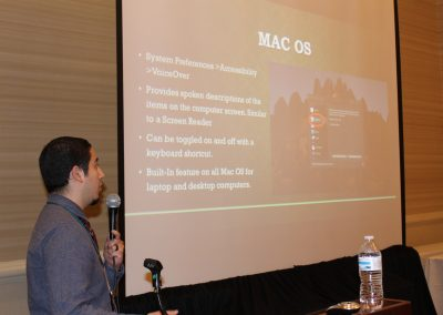 A.T. Coordinator Jesse Armijo presenting built-in accessibility for Mac OS at ATC19
